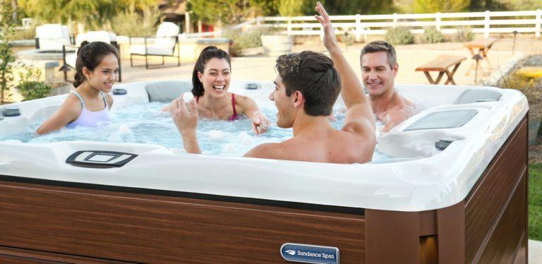 Family enjoying time in their Sundance Spa