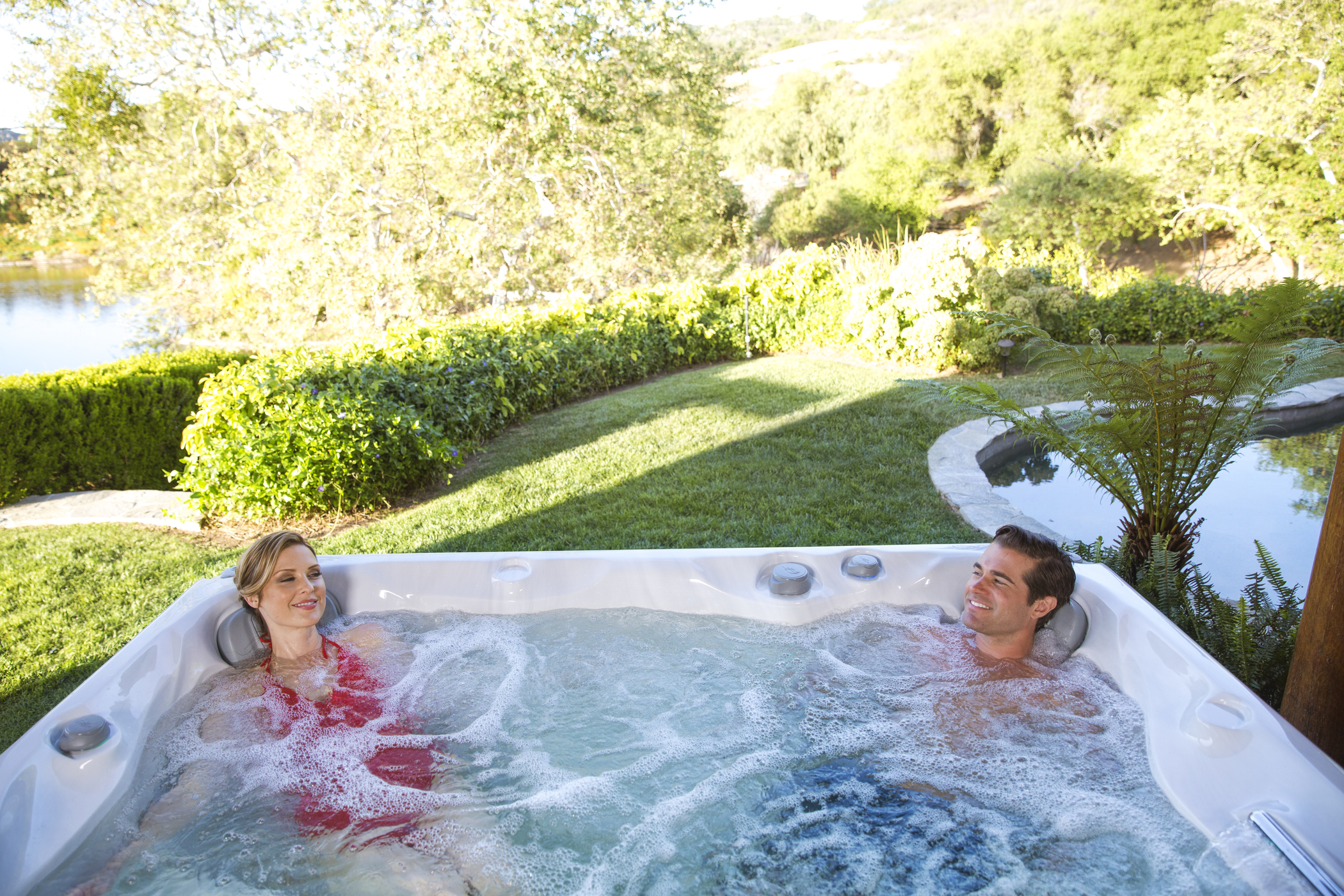 Man and woman soaking in a hot tub Sundance Spas National Pools New Jersey