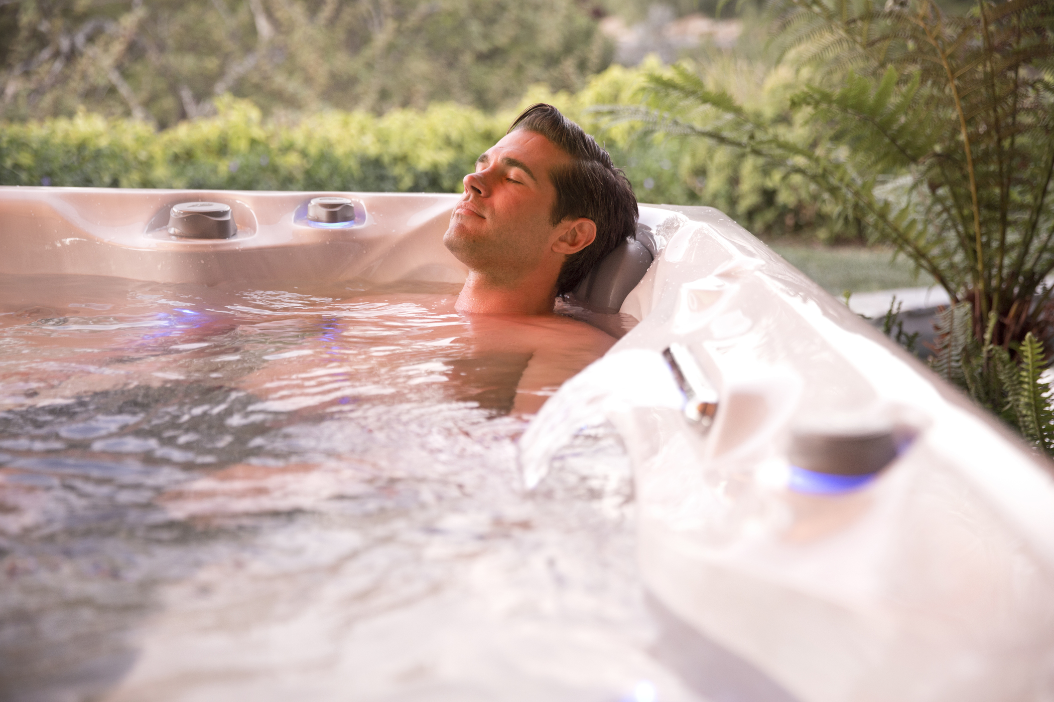 Man soaking in hot tub National Pools New Jersey