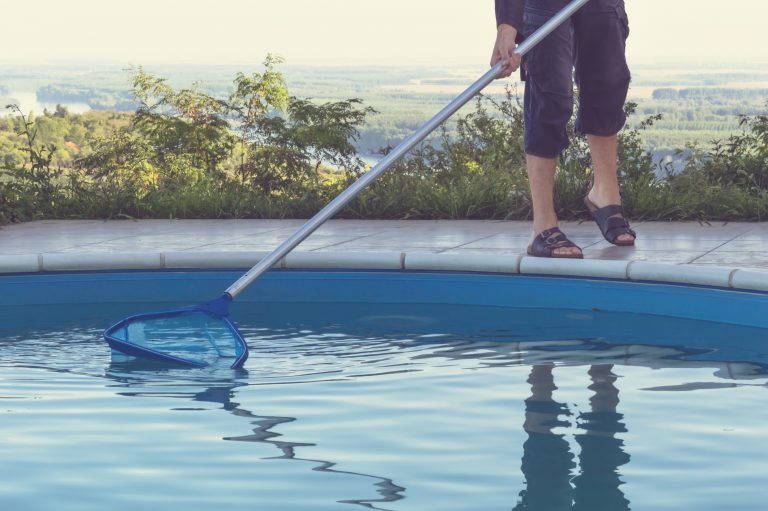 Man cleaning swimming pool