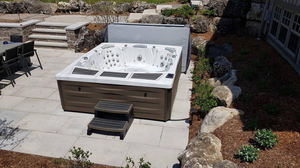 Kingston hot tub installed in a backyard